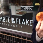 Infobox_pdx_allisonejones_crumbleflake_exterior_woman_croissant